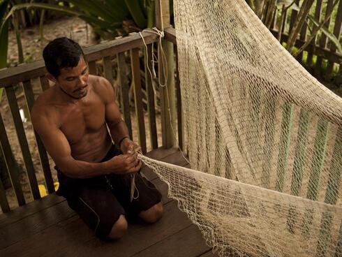 man making fishing net Amazon