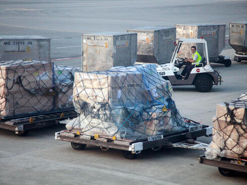 Baggage is moved across the tarmac at an airport.