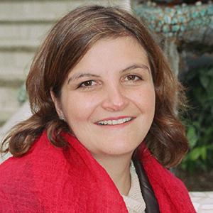 Headshot of Alina Rocha Menocal
