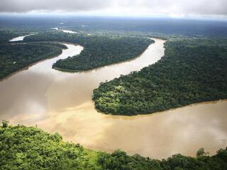 Winding river in Amazon rainforest
