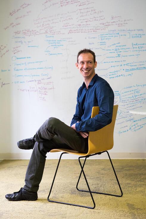 Arnaud Lyet sitting in a chair