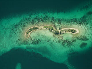 Laughing Bird Caye National Park Aerial view of coral reef from 6,000 ft. Belize