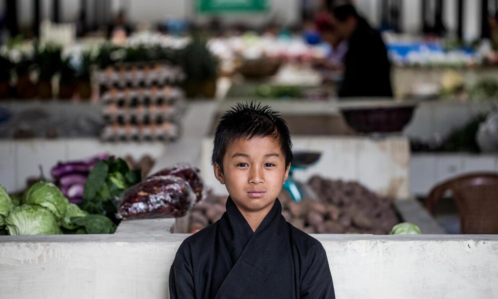 A boy in a market in Bhutan