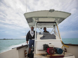 Two lobster fishers on their boat in the Bahamas