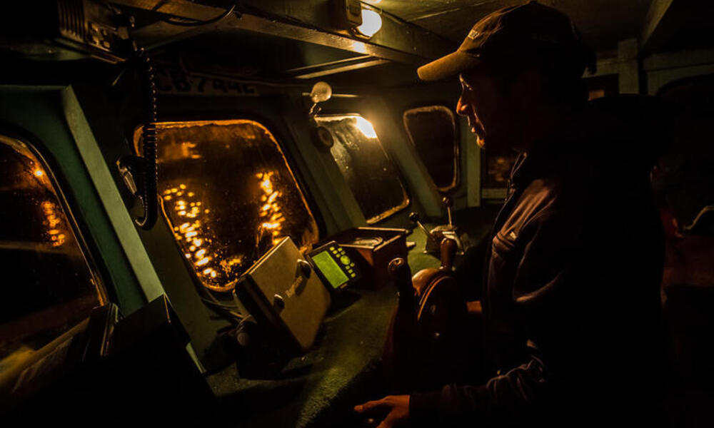 Capitan Fabian Rodriguez, 39, steers his artisanal fishing boat two hours off the Pacific coast of Chile from the port in Concepción, to fish for Southern hake