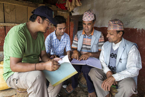 Community leaders in Nepal having a discussion