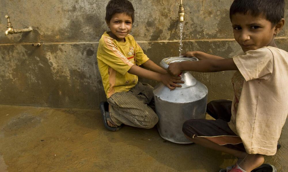 Children collecting spring water
