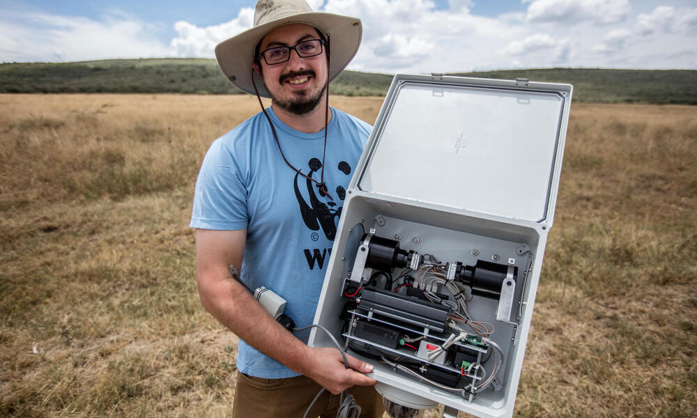 Eric Becker, Conservation Technology Engineer at WWF US, holding his thermal imaging rehoused FLIR camera.