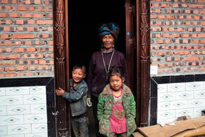 Family participates in energy efficient cookstove project in Liangshan, China