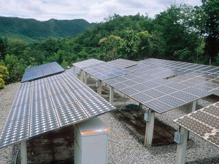 Solar panels in mountain landscape