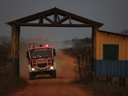 Fire truck on dirt road passing through gate