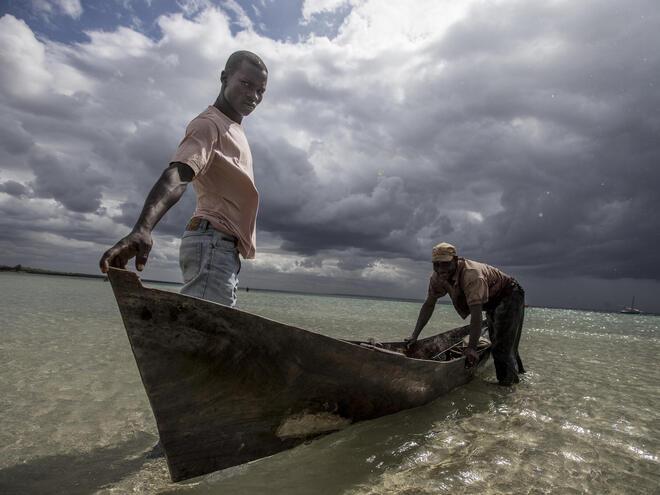 Fisherman in their boats, Ilha de Mafamede, Mozambique.
