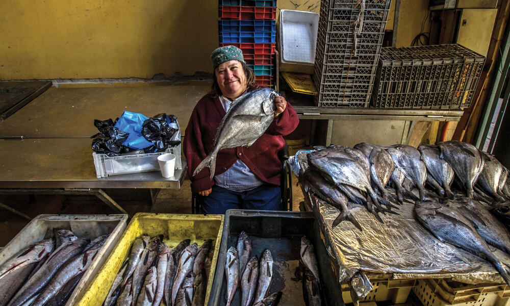Chilean fisherwoman with fish