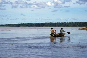 people in dugout canoe, Amazon, Peru