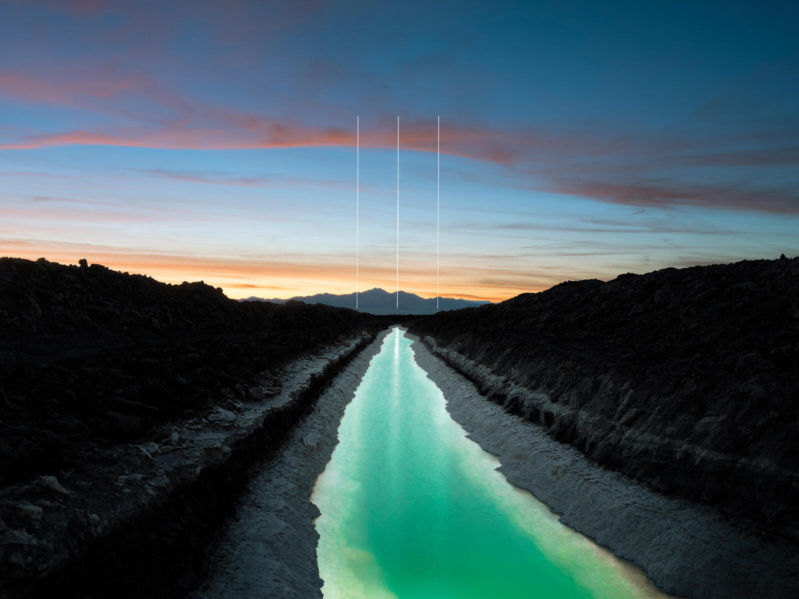Sunset landscape of canal with 3 vertical lines