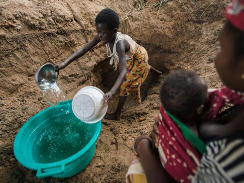 girl filling buckets