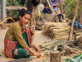 Juni Maya Bhujel making brooms at her house.