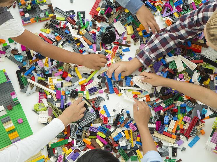 Children play with LEGO bricks