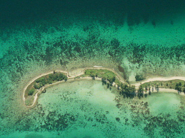 Aerial view of the coral reefs around Laughing Bird Caye National Park, Belize.
