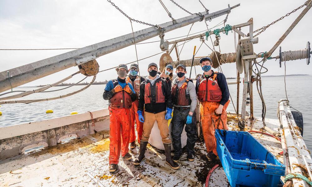 Kelp harvesting crew poses on boat