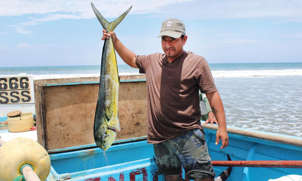man holds fish