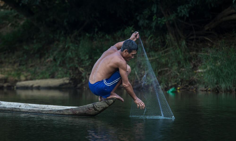 Man fishing in Banchaung river, Myanmar.
