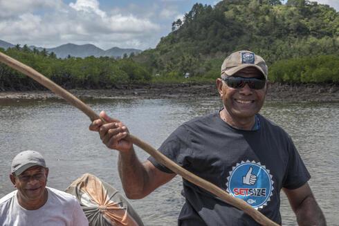 Boating along the Fiji coastline.