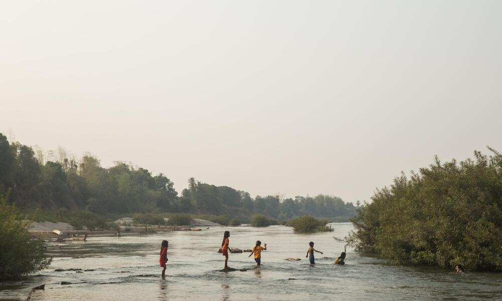 Children play in the Meoking river.