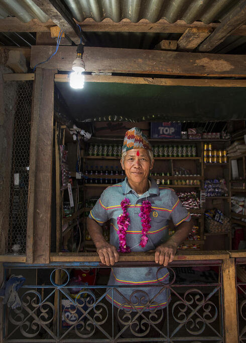 """Sunbir Ghale's house powered by electricity from a """"micro-hydro"""" system"""