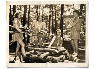 Old photo of Girl Scouts building a fire