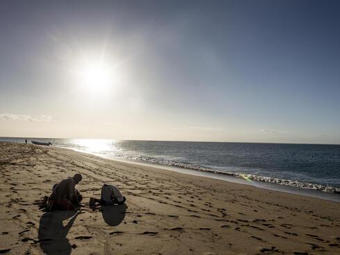 Muslim prayers on beach in Mozambique