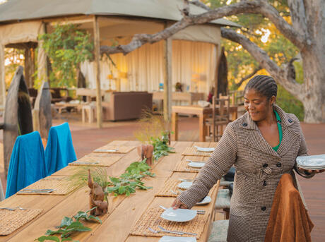 Catherine Mafumelo waitresses at Nambwa Lodge, a joint venture with Mayuni Conservancy in Bwabwata National Park. Namibia's lodges create employment opportunities for community members and provide financial support for conservation efforts.