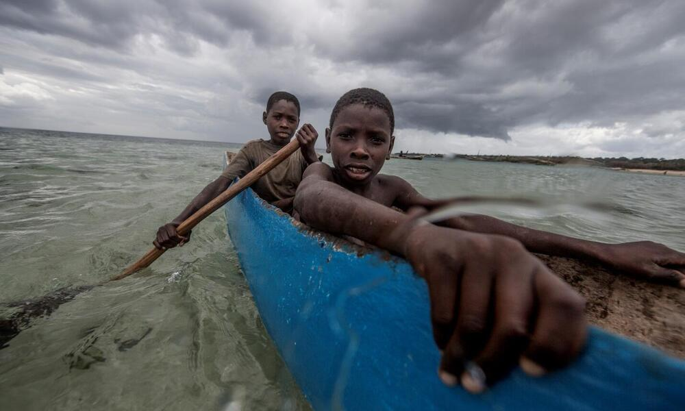 Boys fishing in Nuarro cove