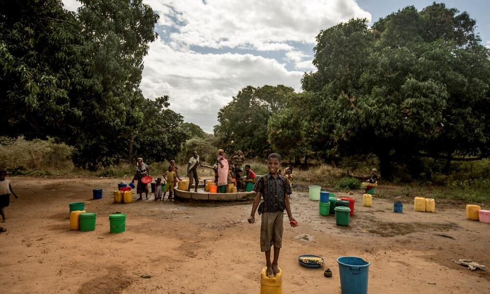 Residents visit a well created by the Nuarro lodge