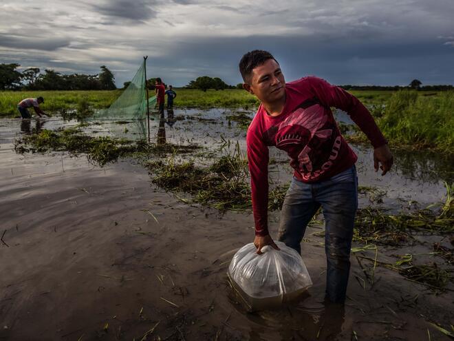 man working on orinoco river