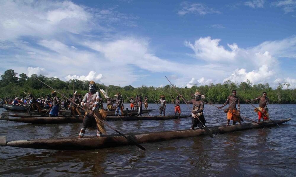 Warriors in canoes
