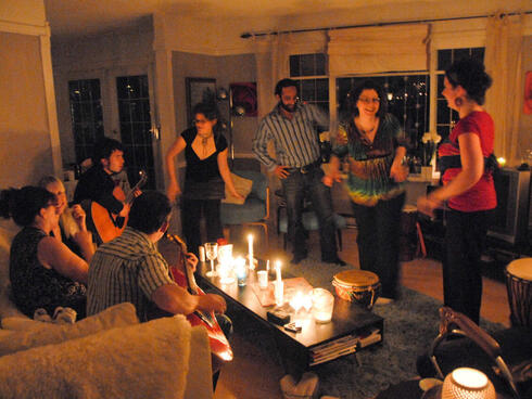 People celebrating the Earth Hour at a candlelight party in Vancouver