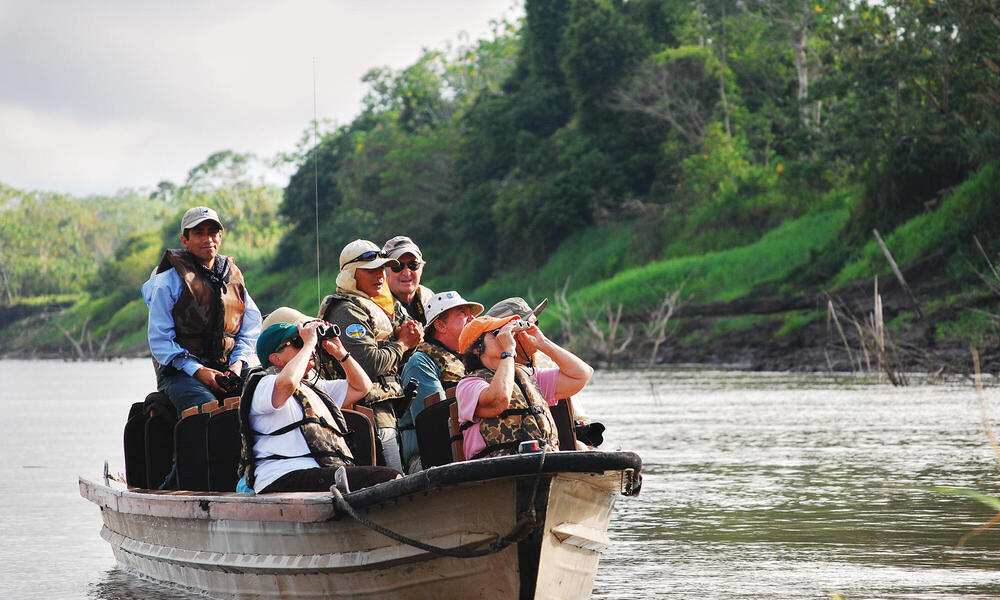 Tourists in boat on Amazon
