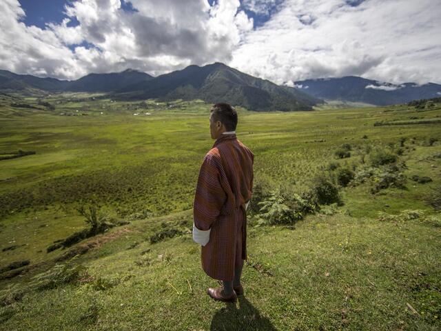 Tashi Dorji stands in Bhutan's Phobjikha Valley