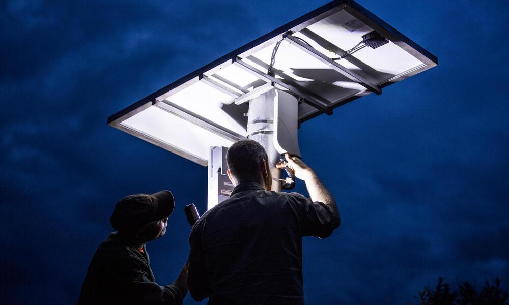 Tower-mounted solar panels for FLIR camera