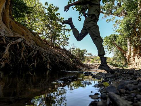 Ranger jumps over creek
