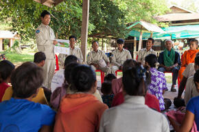 Dorn Bann (47), deputy head of Anlung Cheauteal River Guard Post stands in front of community members during a meeting