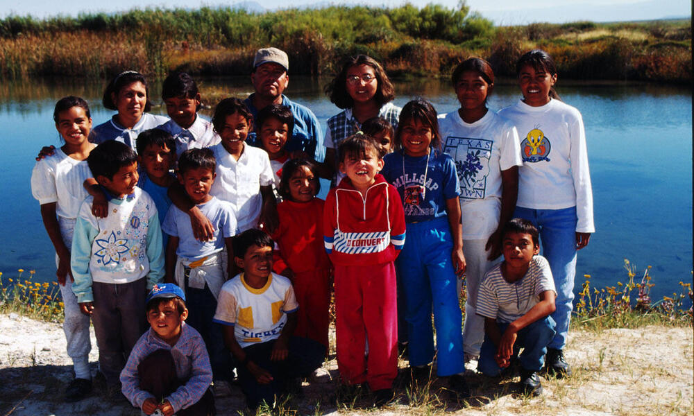 Children from one of the (Ejidos) communal farms visit Cuatrocienigas wetland pools to learn about their local environment Chihuahua Desert, Mexico