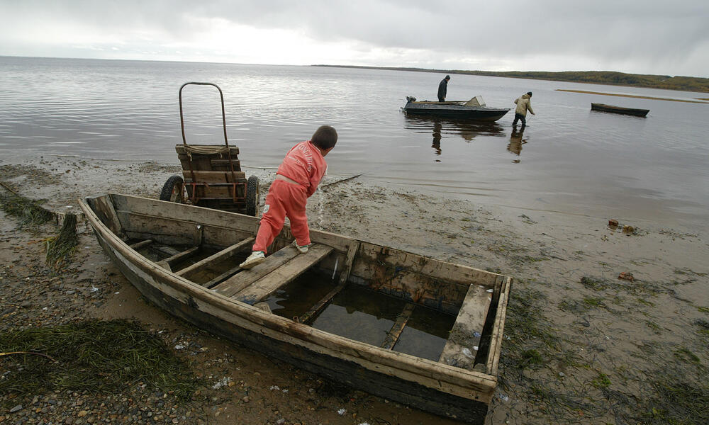 Man fishing for Salmon, Eastern Russia