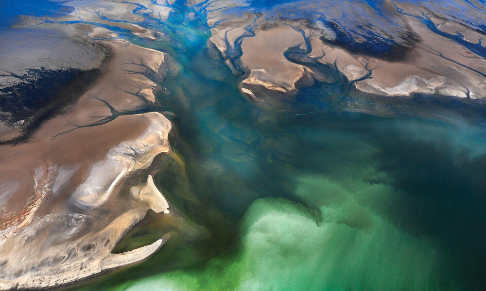 SEA WATER PUSHING INTO DUNES - DESERT COAST