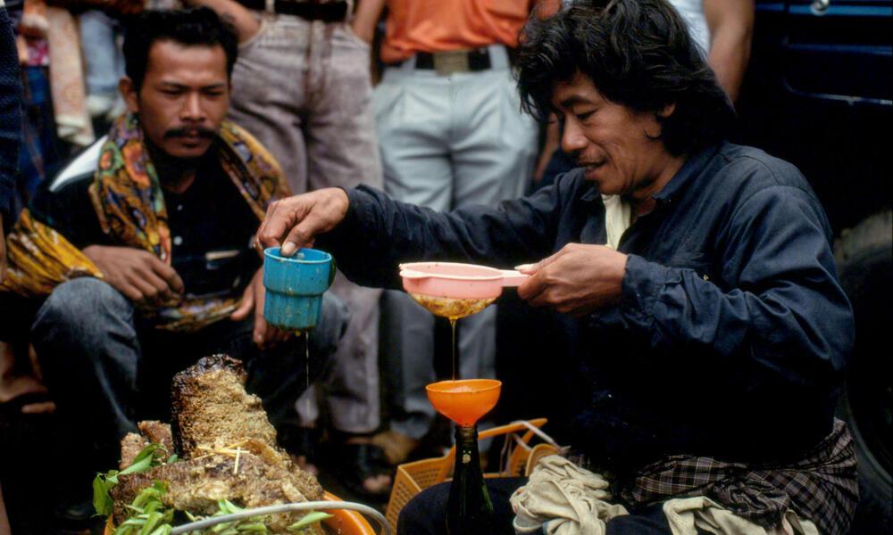 Selling honey at the market. Kerinci region, Sumatra, Indonesia