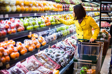 A person shops for food in a grocery store