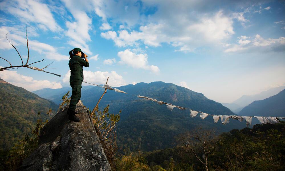 Singye Wangmo, a Bhutan forestry officer looking through her binoculars.