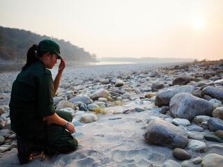Singye Wangmo checking a tiger pug mark.