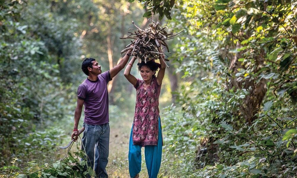 Although Devi's husband is with her in this photo, he regularly travels to find work, leaving much daily life in Devi's hands.
